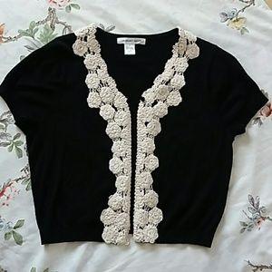 Black short sleeved cardigan w/ white detailing